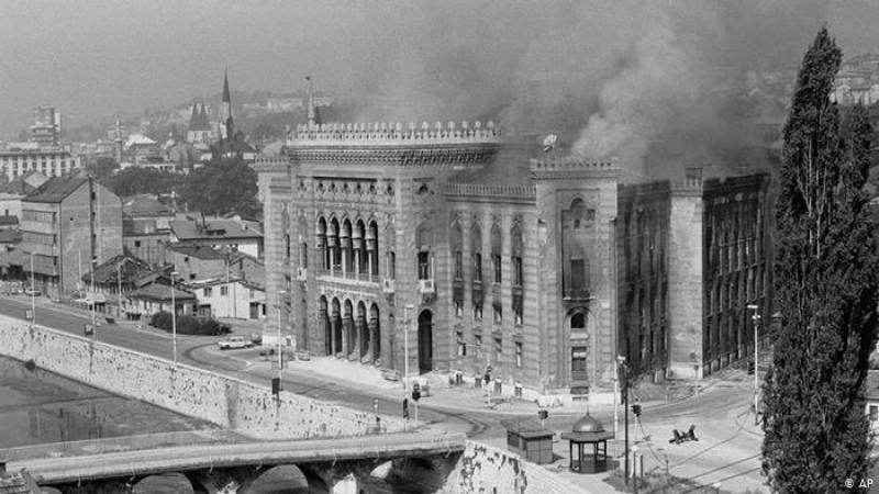 Combo photographs show Sarajevo's National Library burn due to Bosnian Serb shelling in 1992, top, and restored in a photograph made on Thursday Nov. 17, 2005.